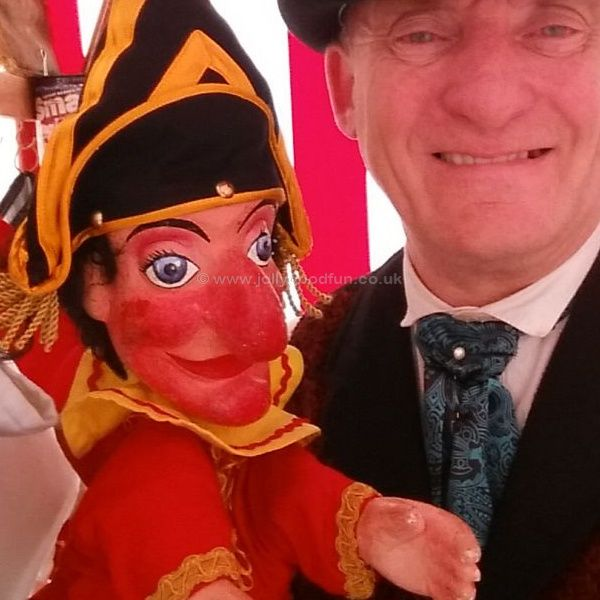Prof Ron Wood holding Mr Punch at Brodsworth Hall, West Yorkshire