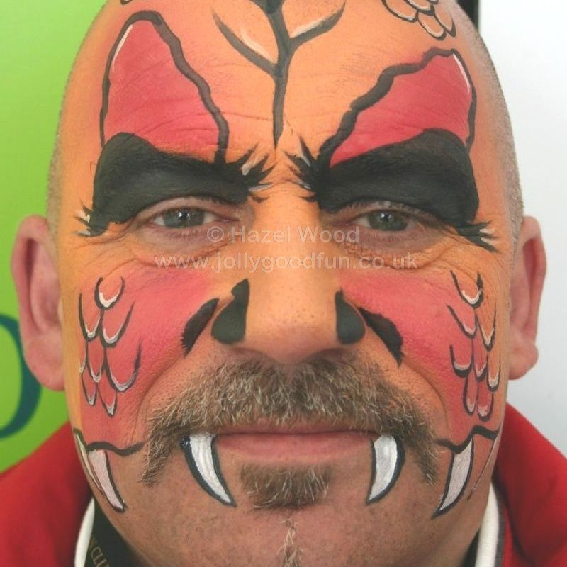 adult with face painted as Fire Dragon