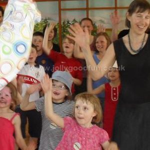 Children and adults doing a party dance