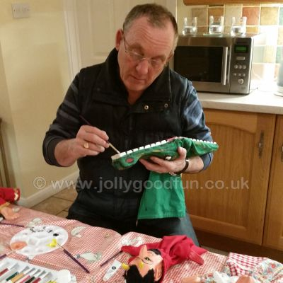 Painting crocodile puppet